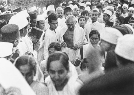 Gandhiji at the Dandi , Gujarat Salt March. Surrounded by adoring crowds, the end of the British Raj came in sight. (Image source - Associated Press File; Courtesy - pressherald.com ).
