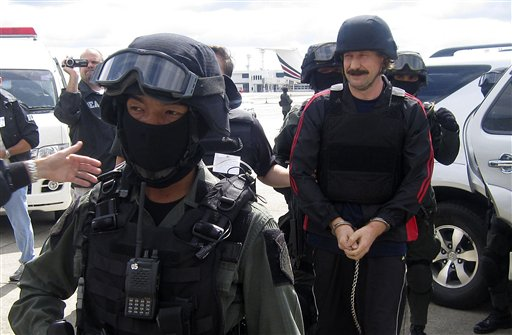 Russian arms dealer Viktor Bout, right, escorted by Thai police commandos, arrives at Bangkok's Don muang airport on Tuesday Nov. 16, 2010. Thailand extradited Bout to the U.S. to face terrorism charges, |  Source-AP Photo; courtesy - THAILAND OUT.