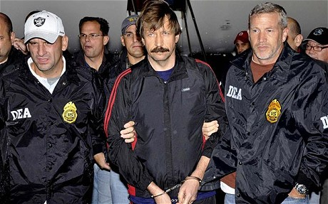 Viktor Bout (C),  Russian arms dealer, in U.S. custody after being flown from Bangkok to New York Photo: AP