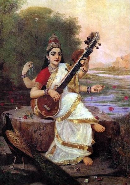 Saraswati sits on the bank of a river, holds a book and beads, and plays music on Veena, as a peacock looks on, in a painting by Raja Ravi Varma  |  Painting of the Goddess Saraswati by Raja Ravi Varma (1848–1906); currently housed at the English: Maharaja Fateh Singh Museum, Lakshmi Vilas Palace, Vadodara, Gujarat.