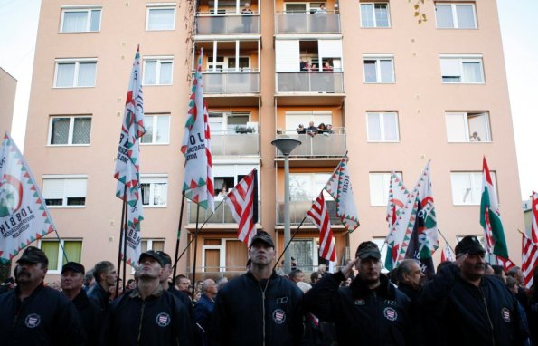 Jobbik sparked an uproar by calling for Jews in the country to be registered. Jobbik supporters demonstrate outside a housing project with many Roma residents in October 2012.  |  REUTERS image, courtesy Der Spiegel