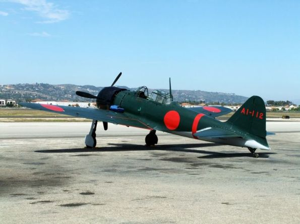 One of the world's four airworthy Zero fighters sits on the tarmac in August 2011 in California, decked out in its full Pacific War livery. (Image courtesy - ajw.asahi.com; source - Masahide Ishizuka)