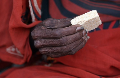 Food aid is frequently a market seeding program to create markets for Western food multinationals. A Somali refugee with a high-energy biscuit at the Ifo refugee camp on July 24, 2011 in Dadaab, Kenya.  |  Image source - Oli Scarff/Getty Images; courtesy - theatlantic.com