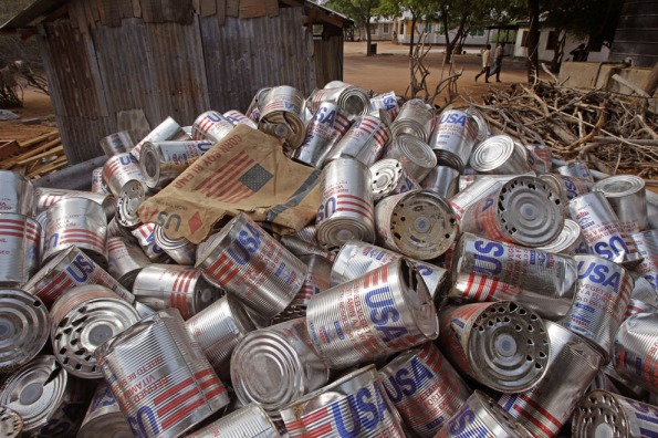 Used food tins with overwhelming propaganda branding stacked near the town of Dadaab, Kenya, on Tuesday, July 26, 2011. |  Image source - AP Photo/Schalk van Zuydam; courtesy - theatlantic.com